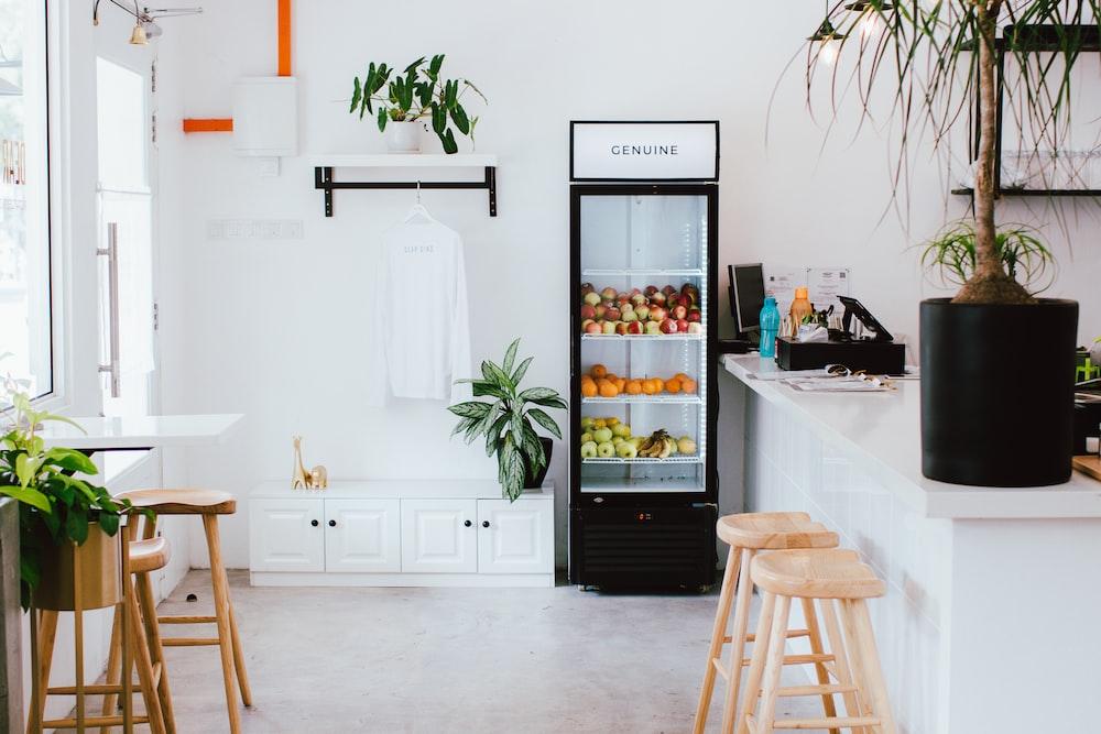 black refrigerator near kitchen island