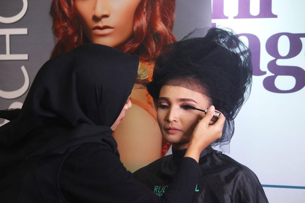 woman in black shirt standing