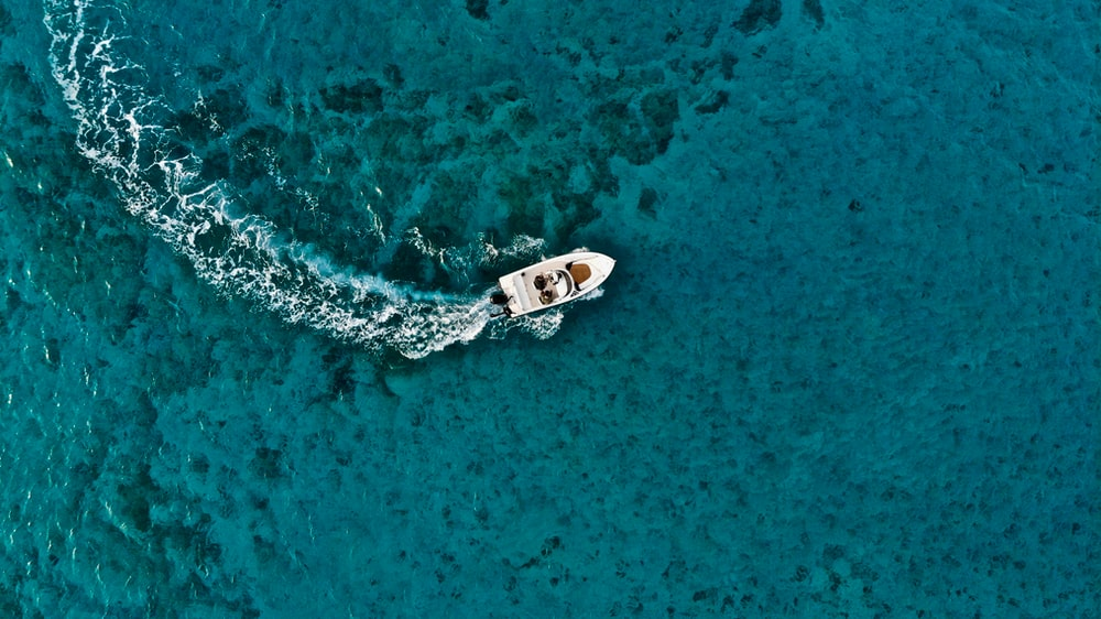 aerial photo of boat on sea during daytime