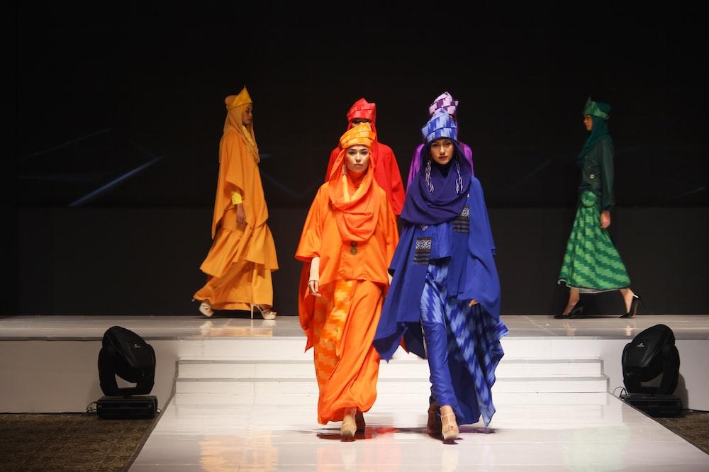 woman wearing dresses walking on catwalk