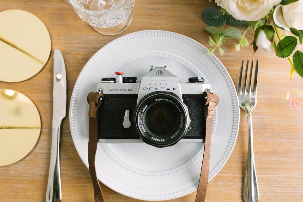 black and grey Pentax SLR camera