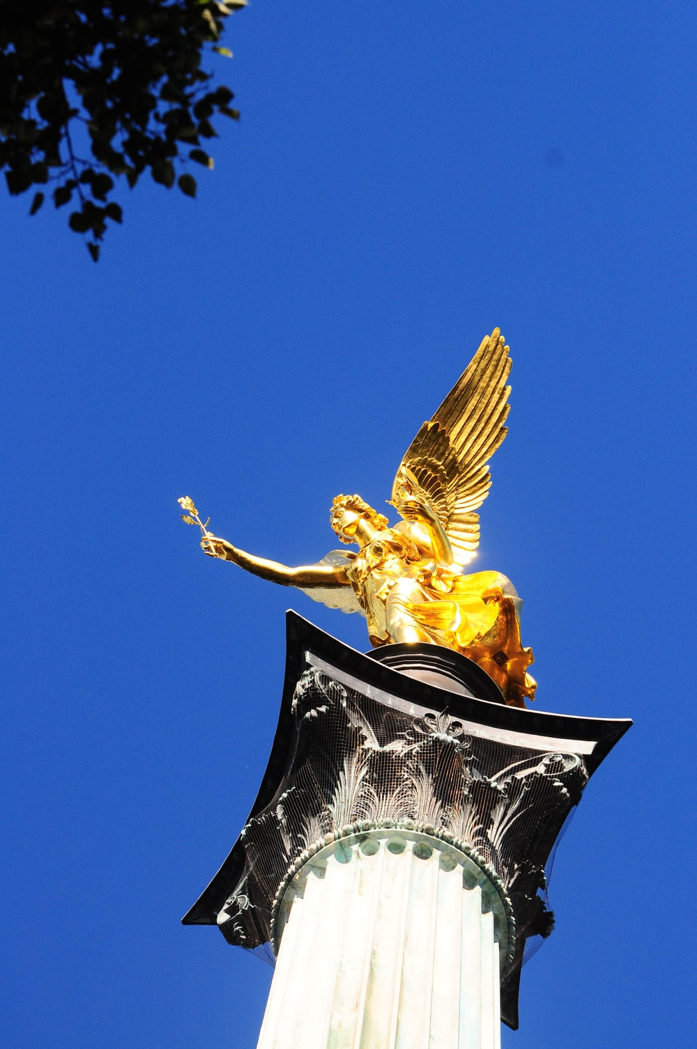 low angle photo of angel statue