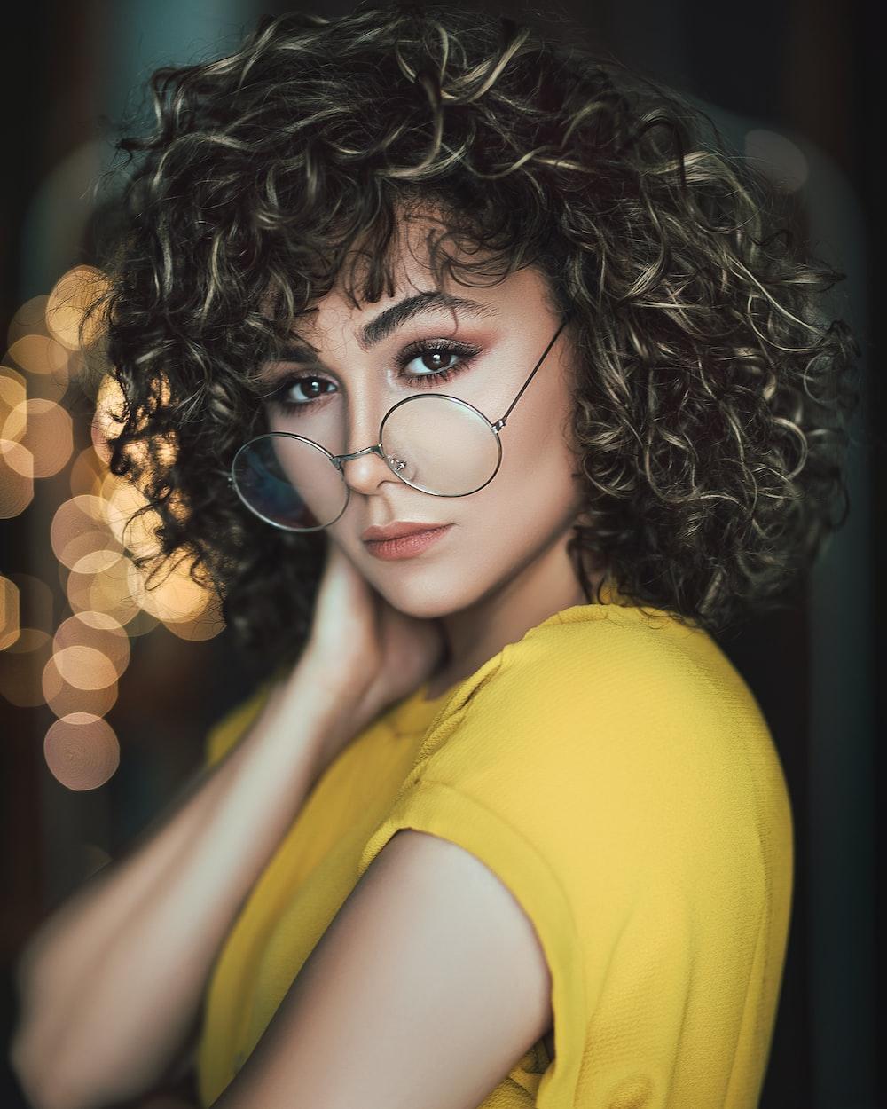 woman wearing hippie eyeglasses with bokeh lights