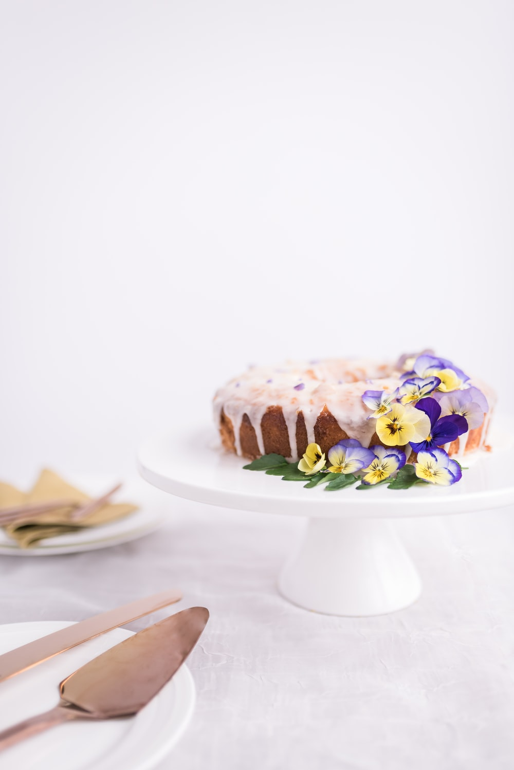 cake on ceramic footed plate