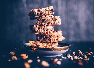piled cookies on ceramic snack plate