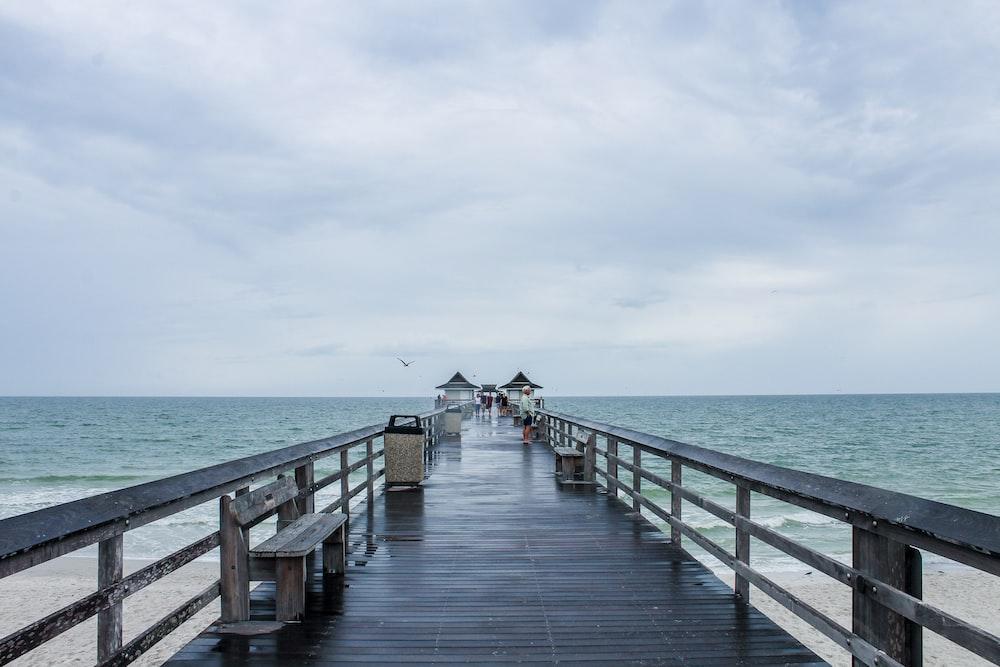 black wooden ocean dock photography