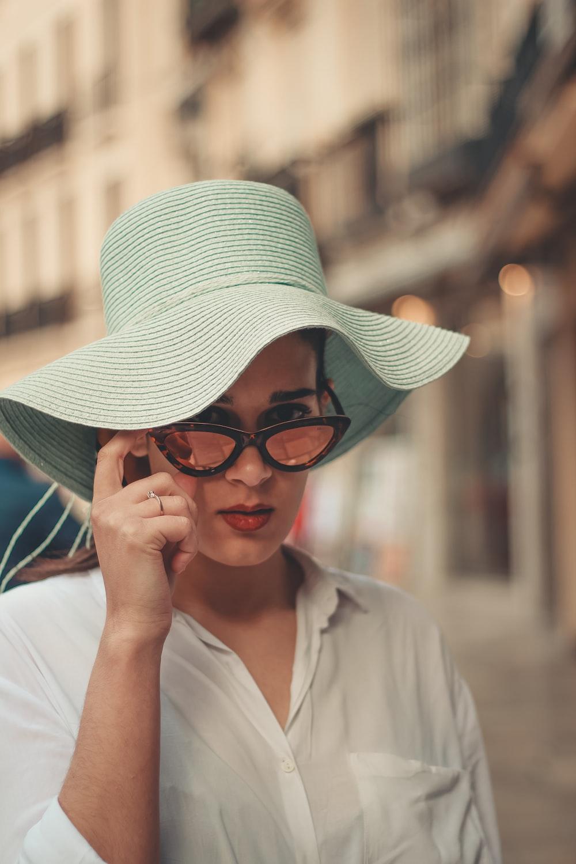 woman wearing teal sun hat