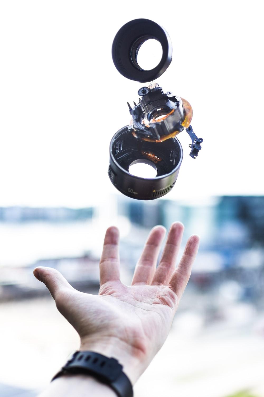 person thrown camera lens