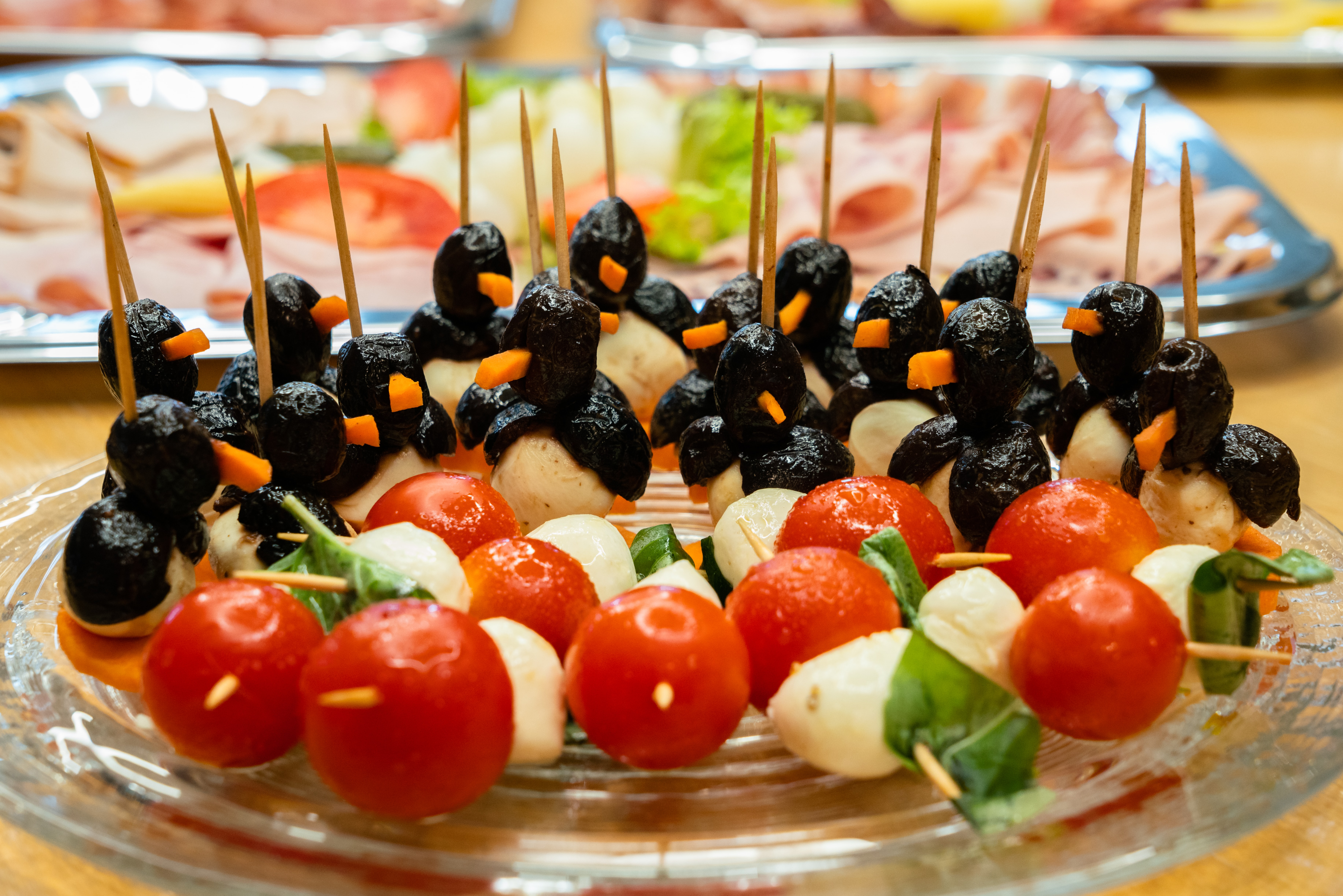 fruits and olives topped cake