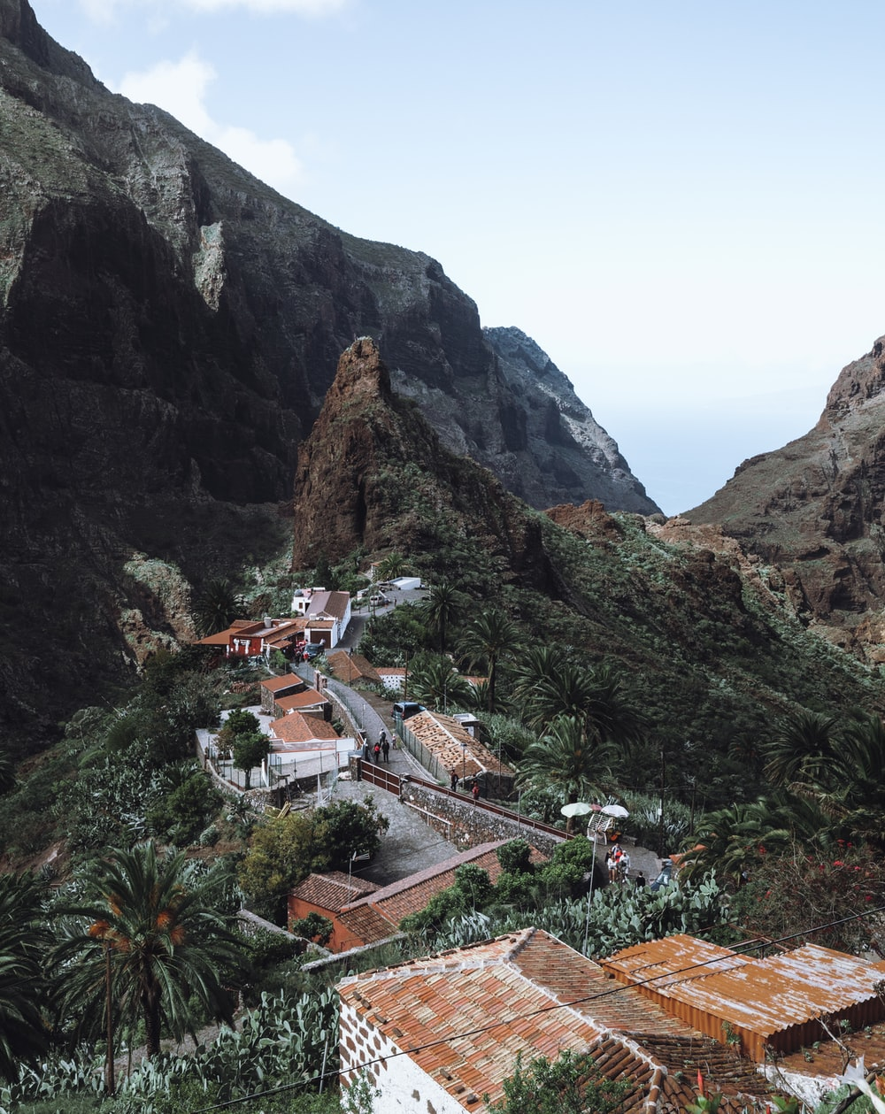 houses near mountain during daytime
