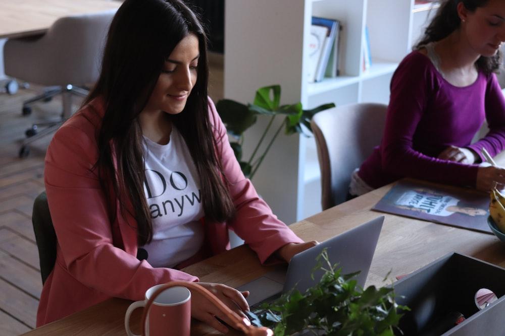 woman sitting facing on laptop