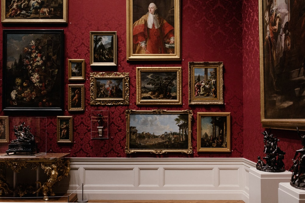 assorted picture frames on wall