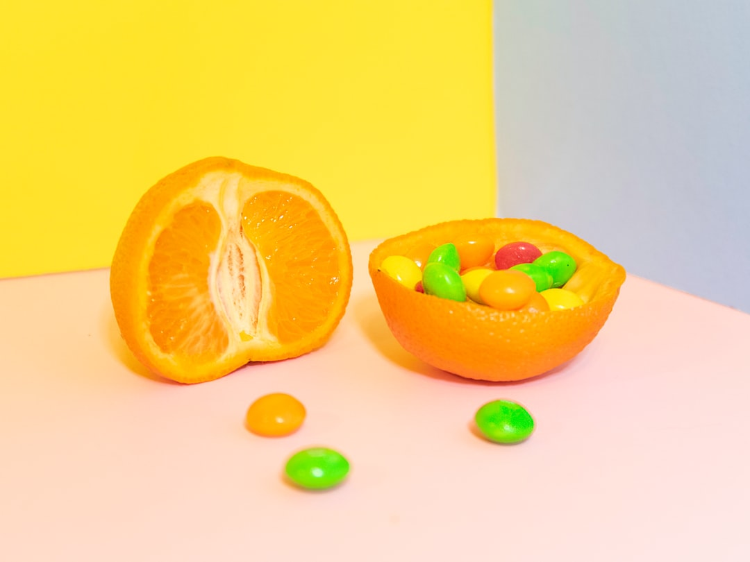 Today, the craft service table on the set of Spider-Man: Far from Home, they had a plethora of awesome things to eat, but the Skittles and clementines caught my eye. Should I choose a healthy and juicy piece of fruit or should I taste the rainbow? I opted for both and simply took three pieces of colored foam core as the background and snapped away. **Fun fact: clementines are easy to peel without ripping. Make sure to dry them off so that they don't drip on the foam core and ruin it.