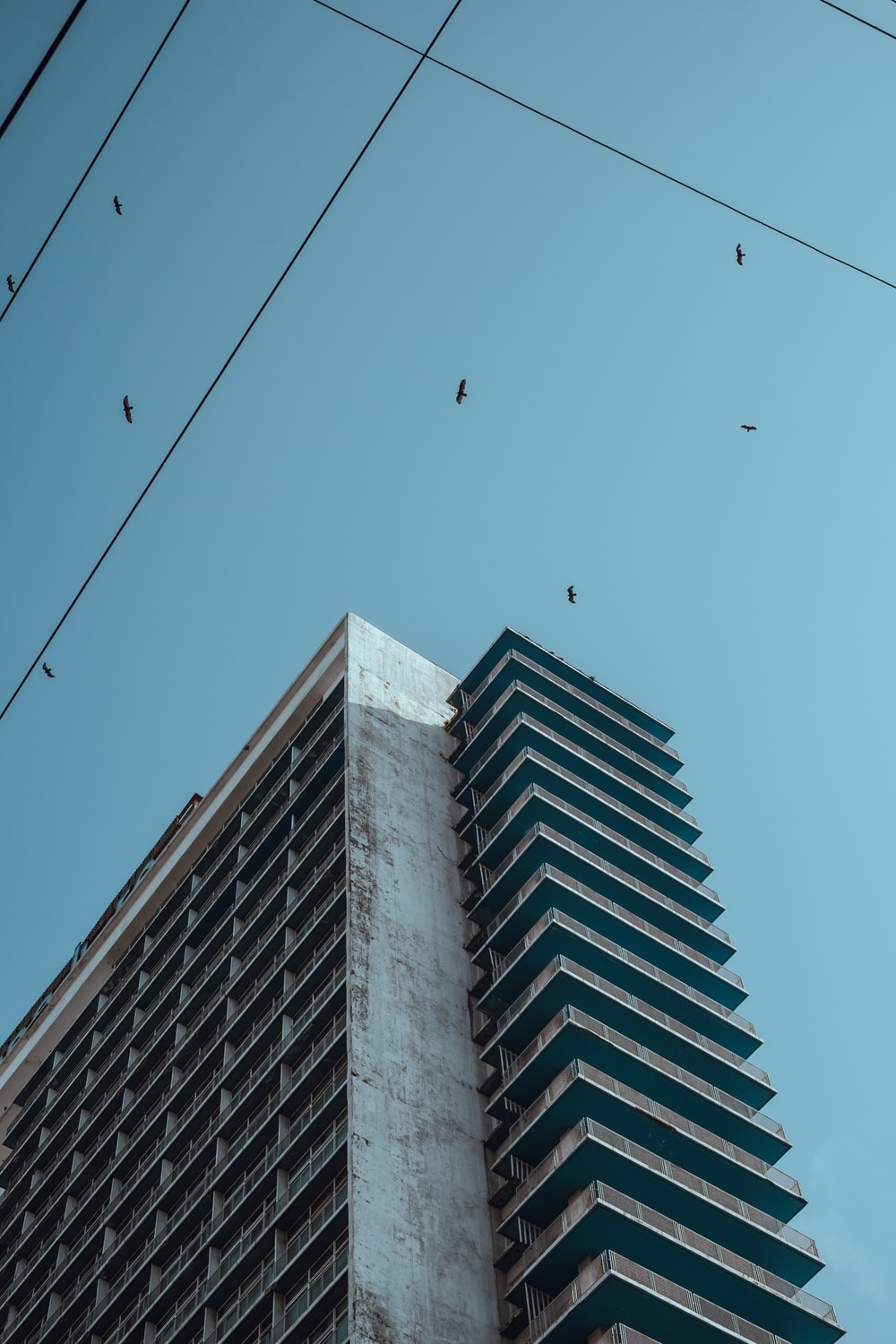 low-angle photography of gray concrete high-rise building during daytime