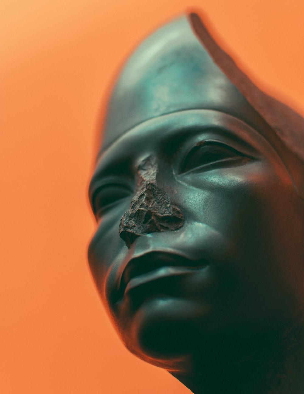 grey ceramic man's face statue