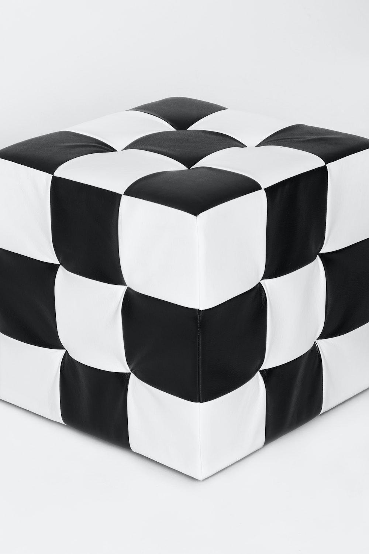 square white and black leather ottoman