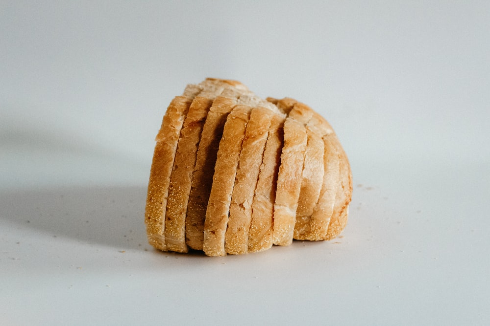 sliced of bread on top of white surface