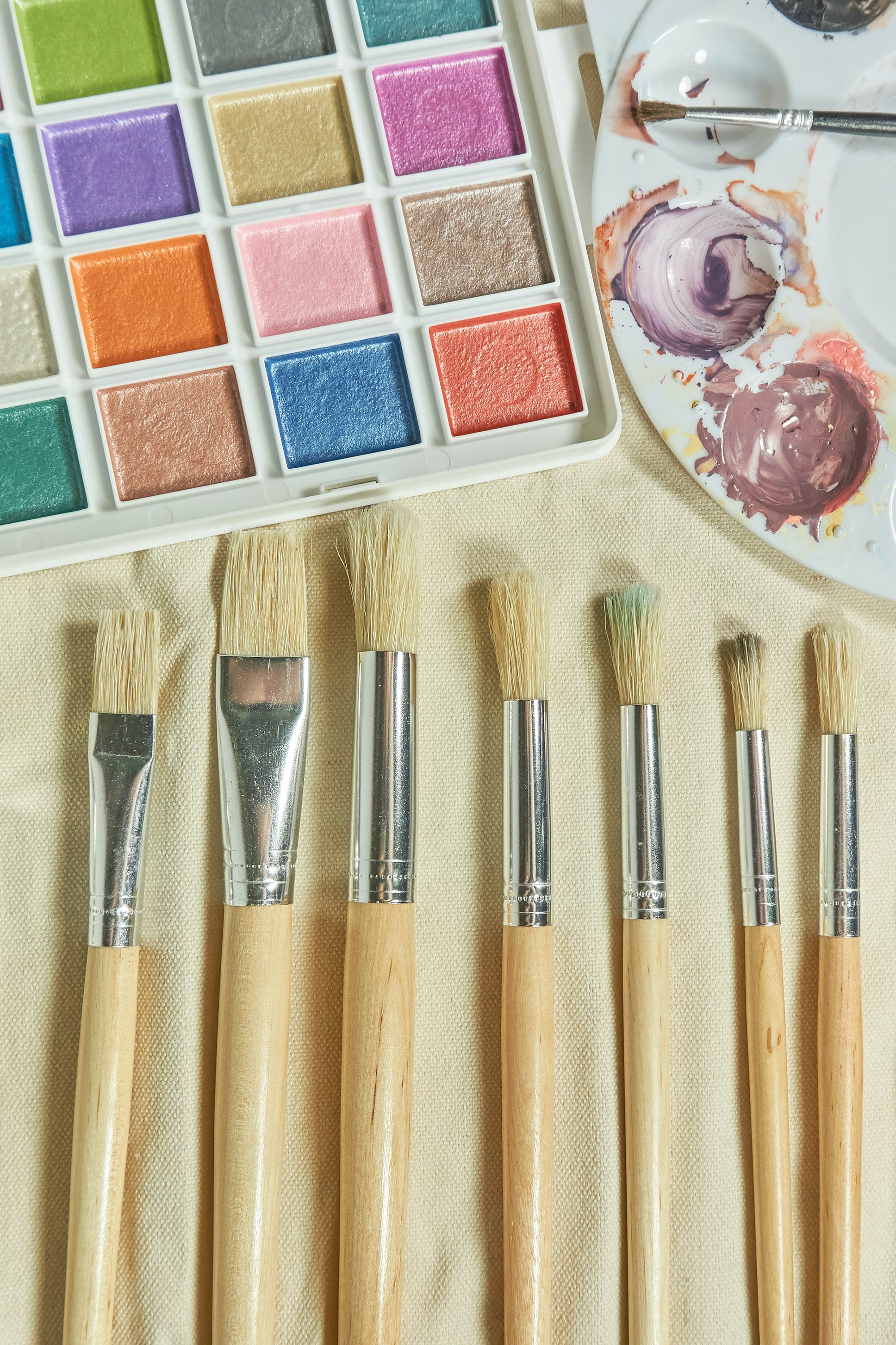 seven brushes and water color palette