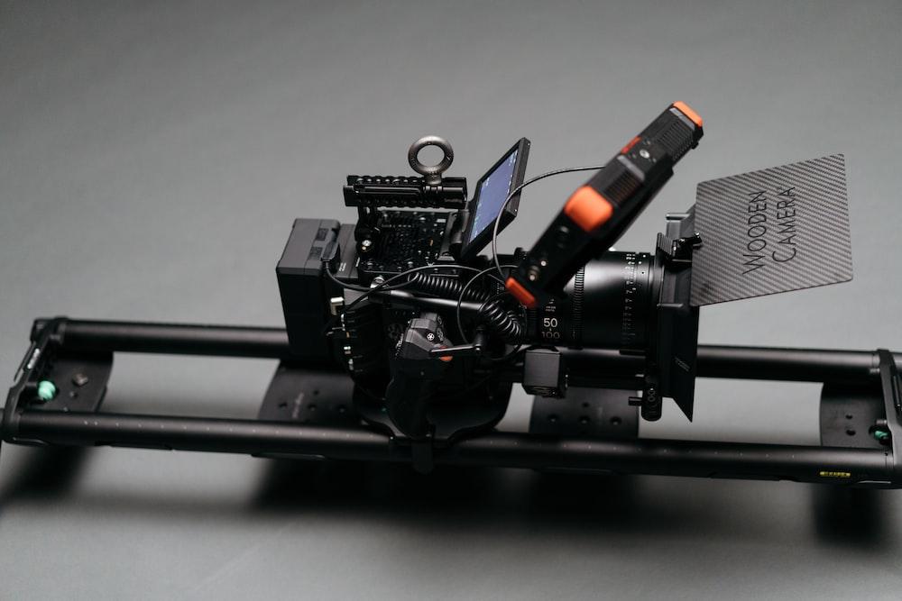 black video camera on slider ad on