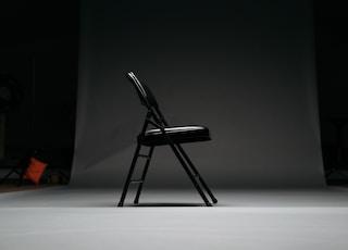 black metal framed padded folding chair