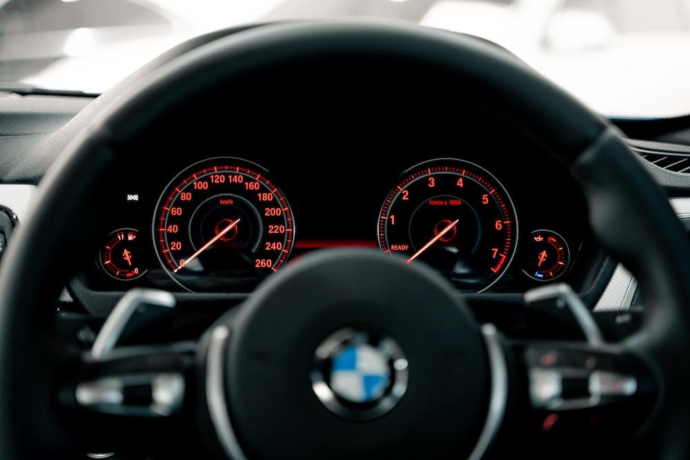black BMW vehicle steering wheel