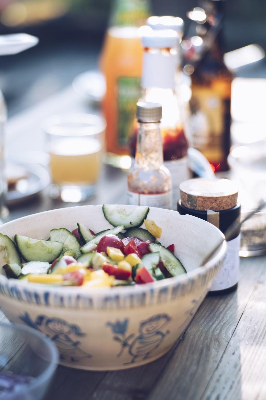 salad on white bowl