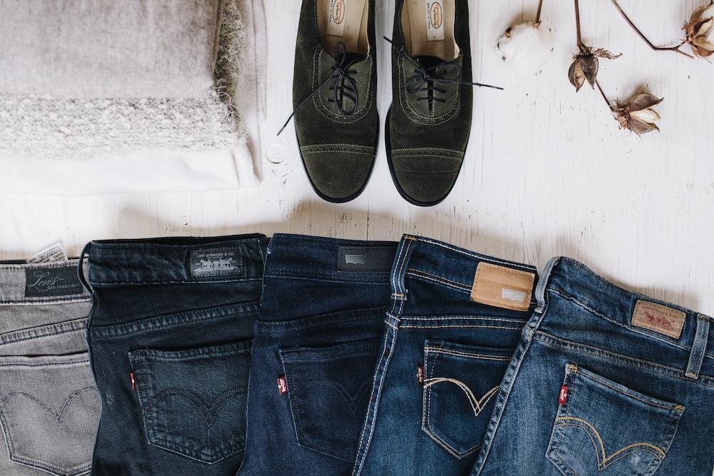 five denim jeans near black shoes