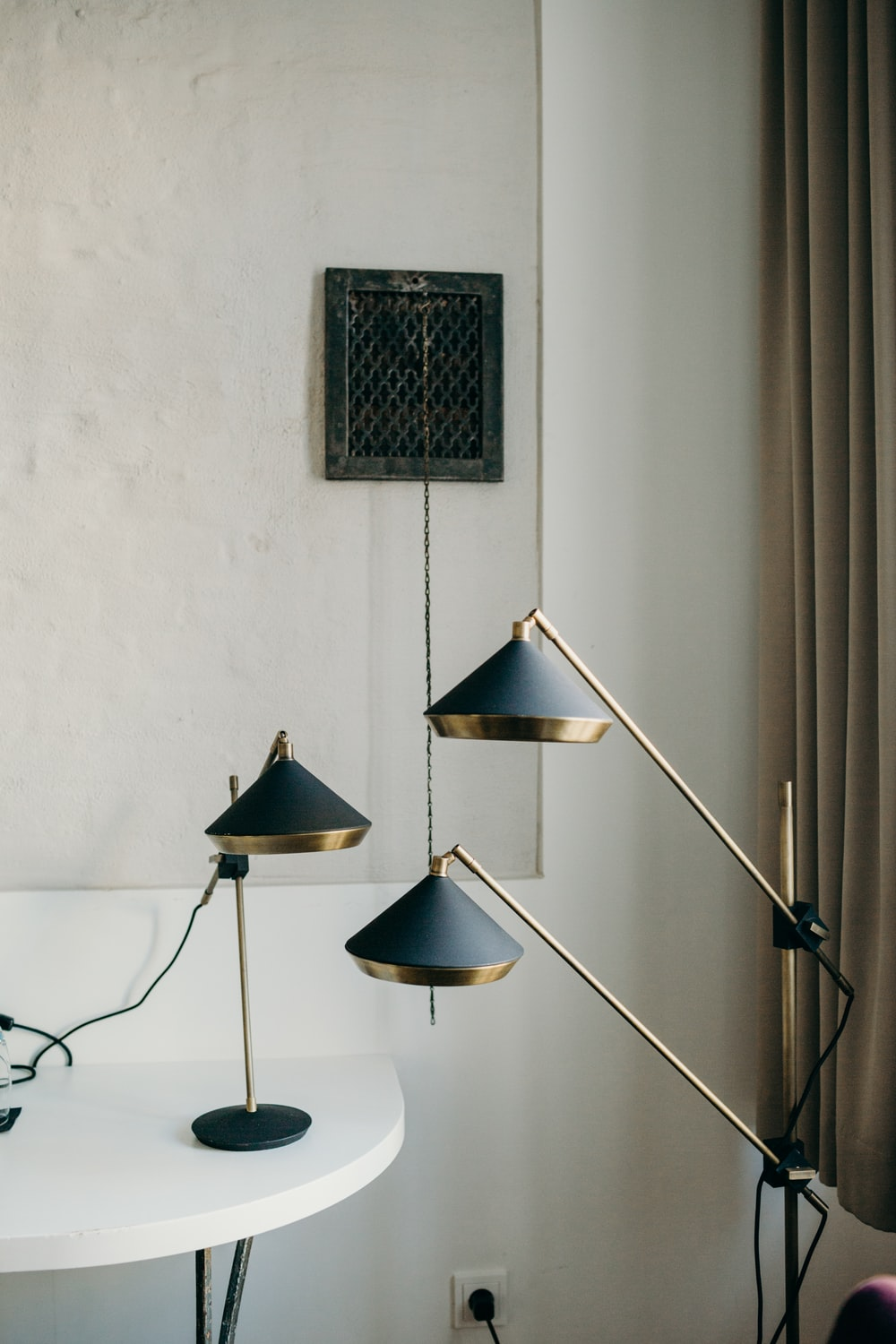 black and brass-colored reading lamps
