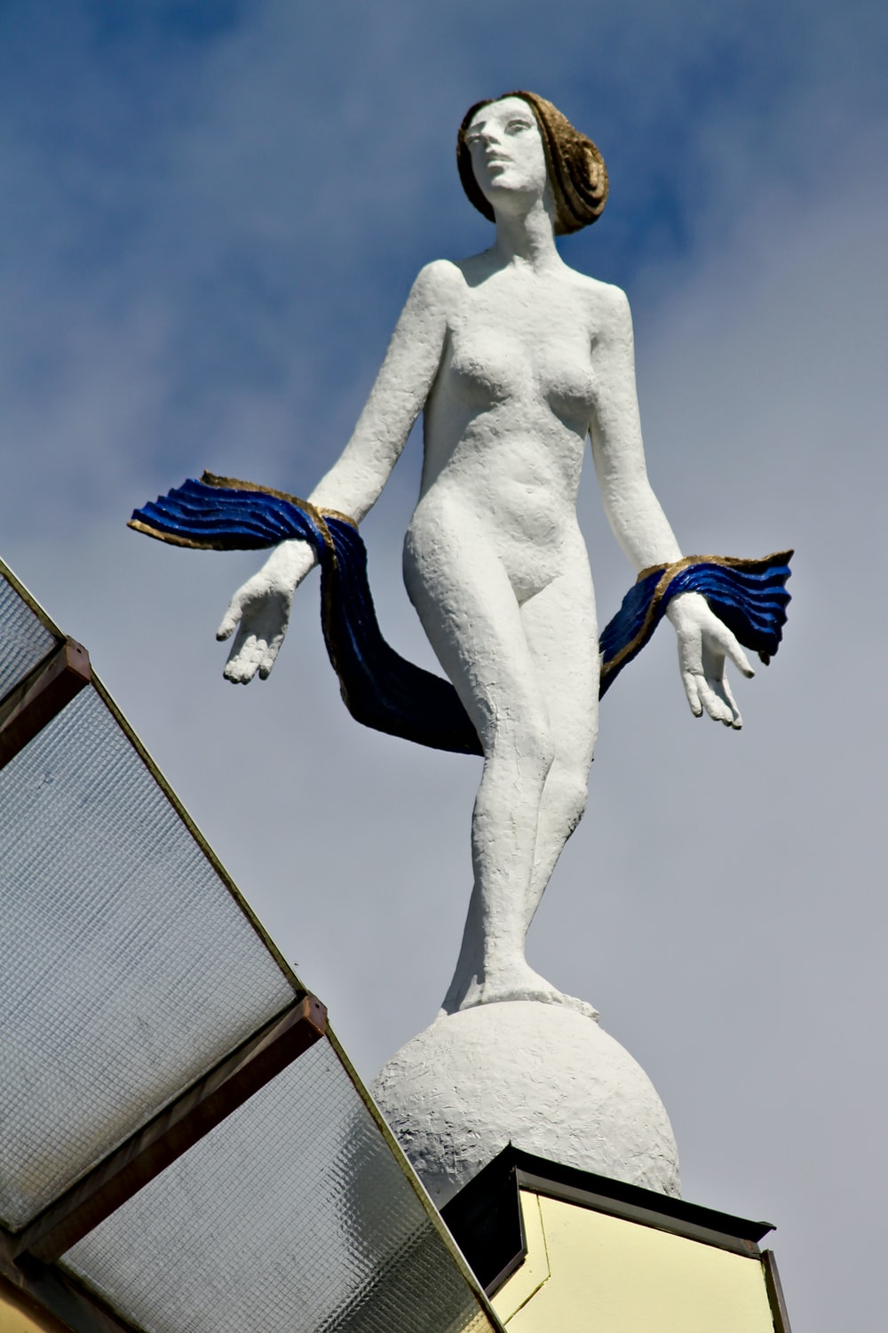 naked woman with blue scarf sculpture