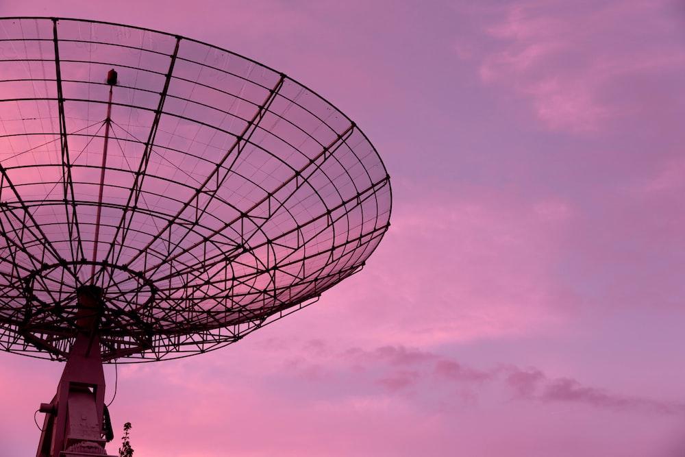 black satellite under blue sky