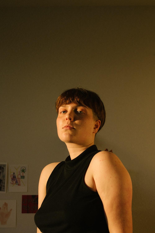 woman in black sleeveless top