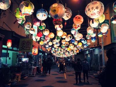 people standing under the lantern street lantern festival teams background