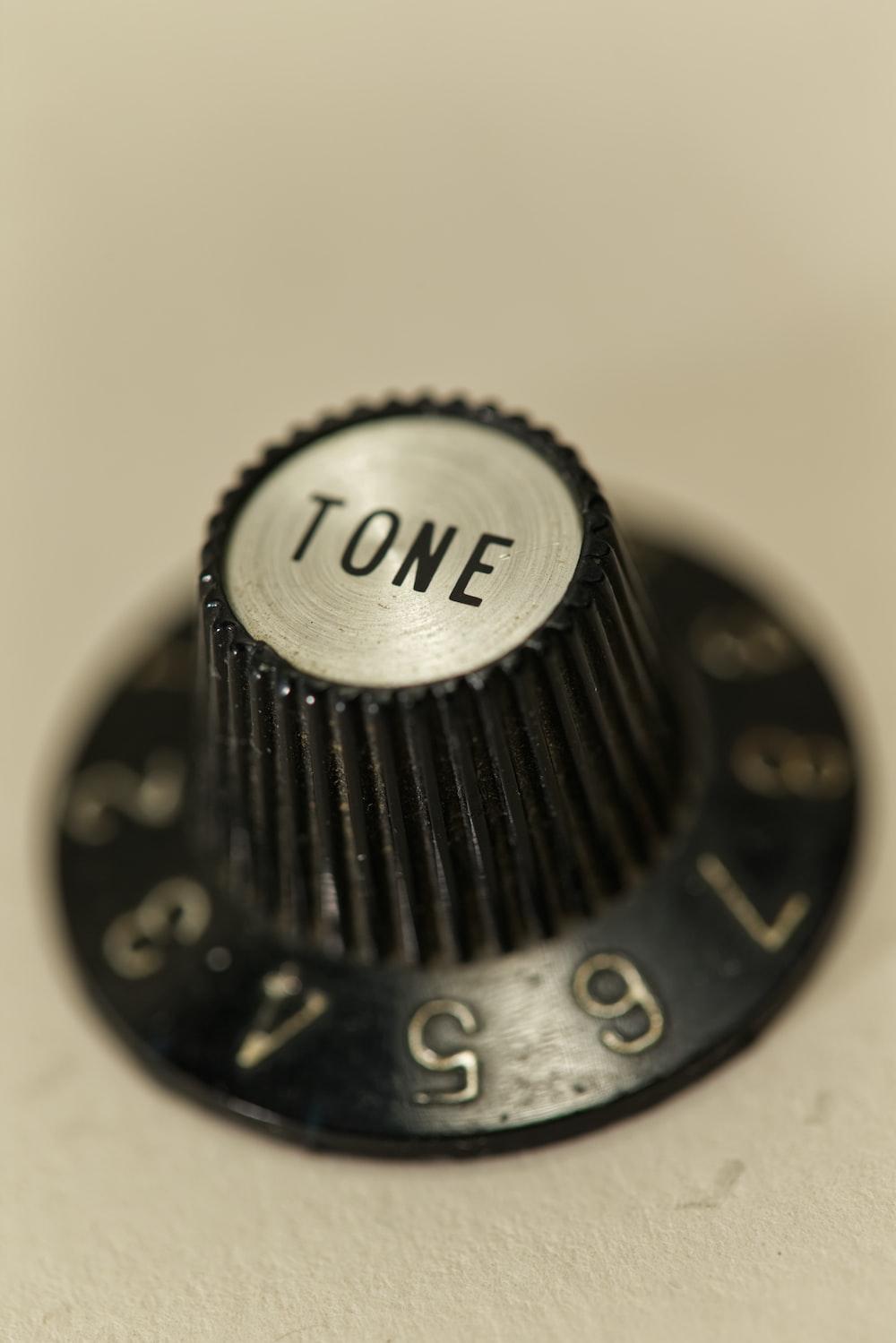 Tone control knob on white surface
