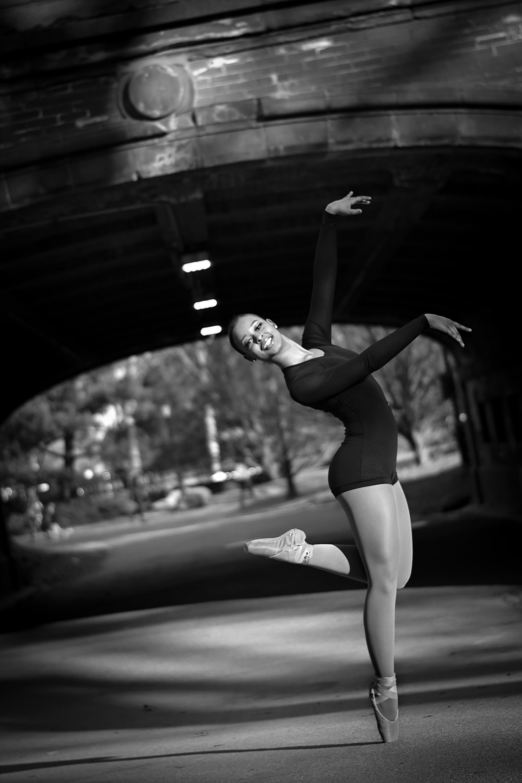 greyscale photo of dancing woman