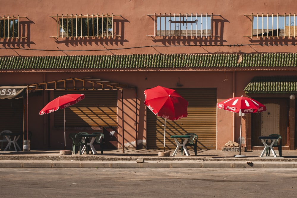 red parasols near store