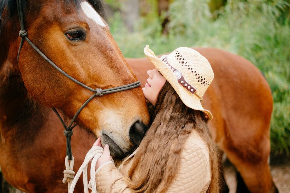 woman beside horse
