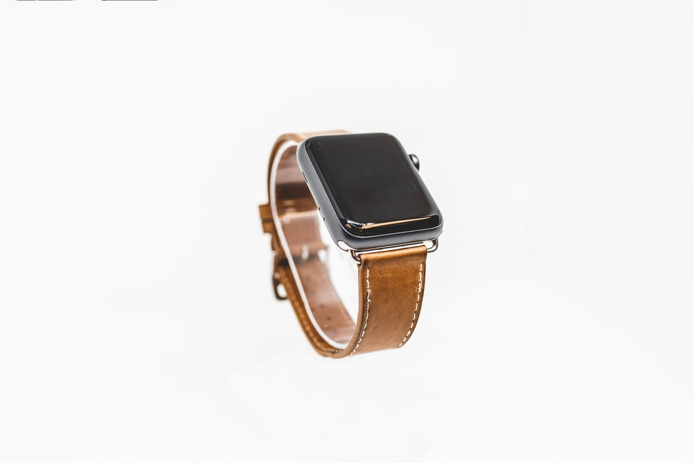 space gray aluminum case apple watch with brown leather strap