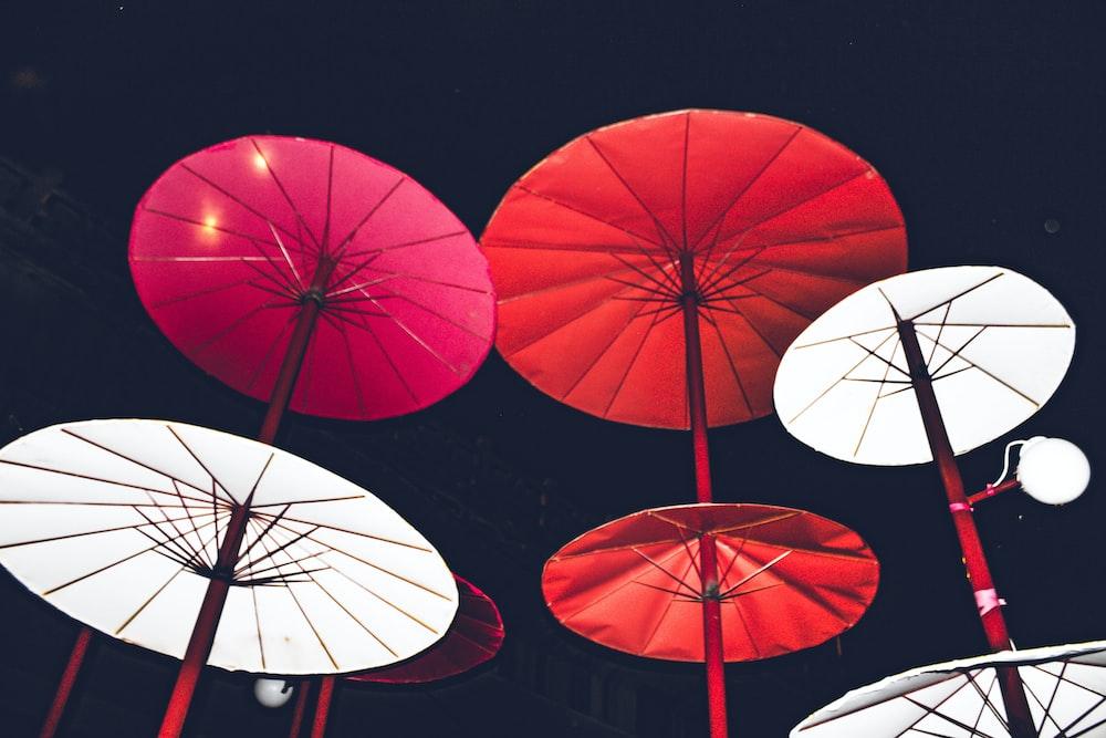 assorted-colored Japanese paper umbrellas