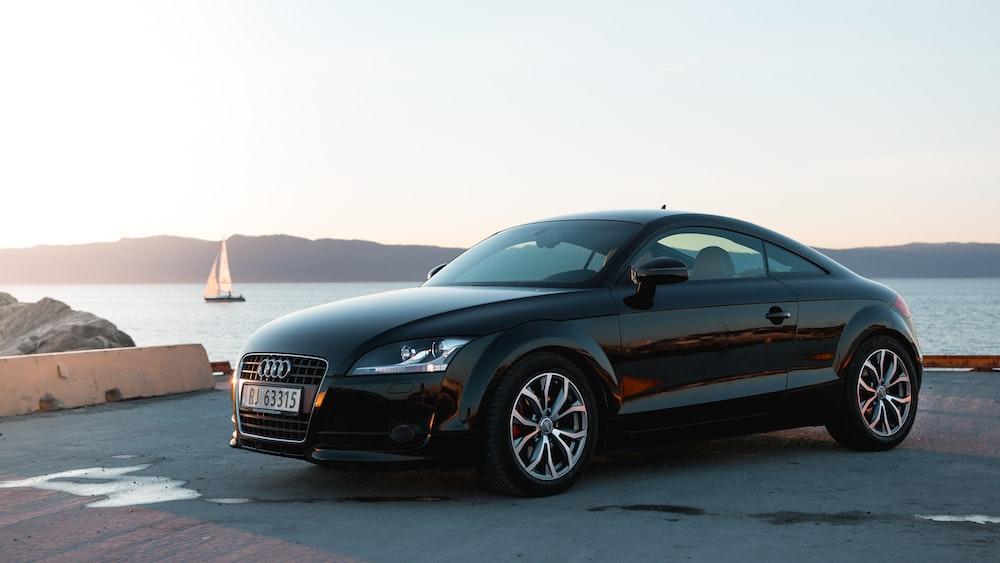 black Audi coupe near ocean