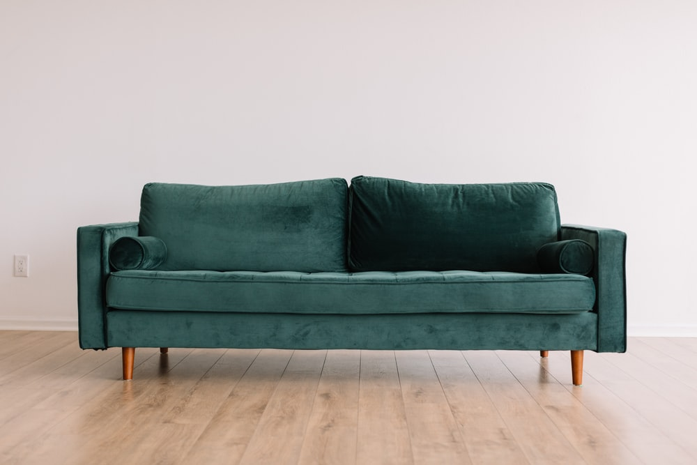green fabric sofa