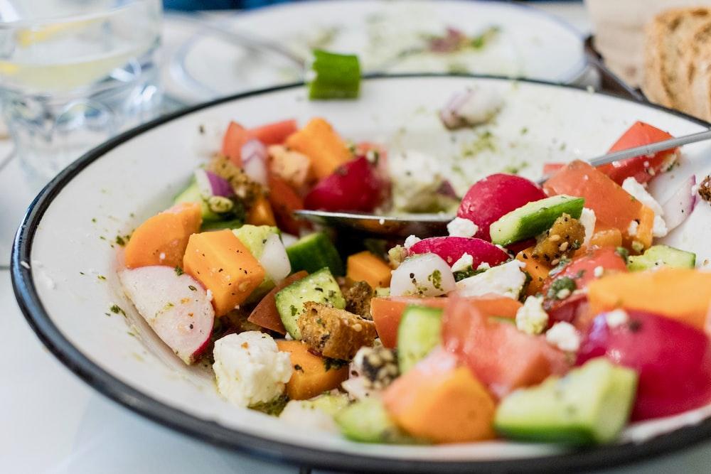 salad on round white plate