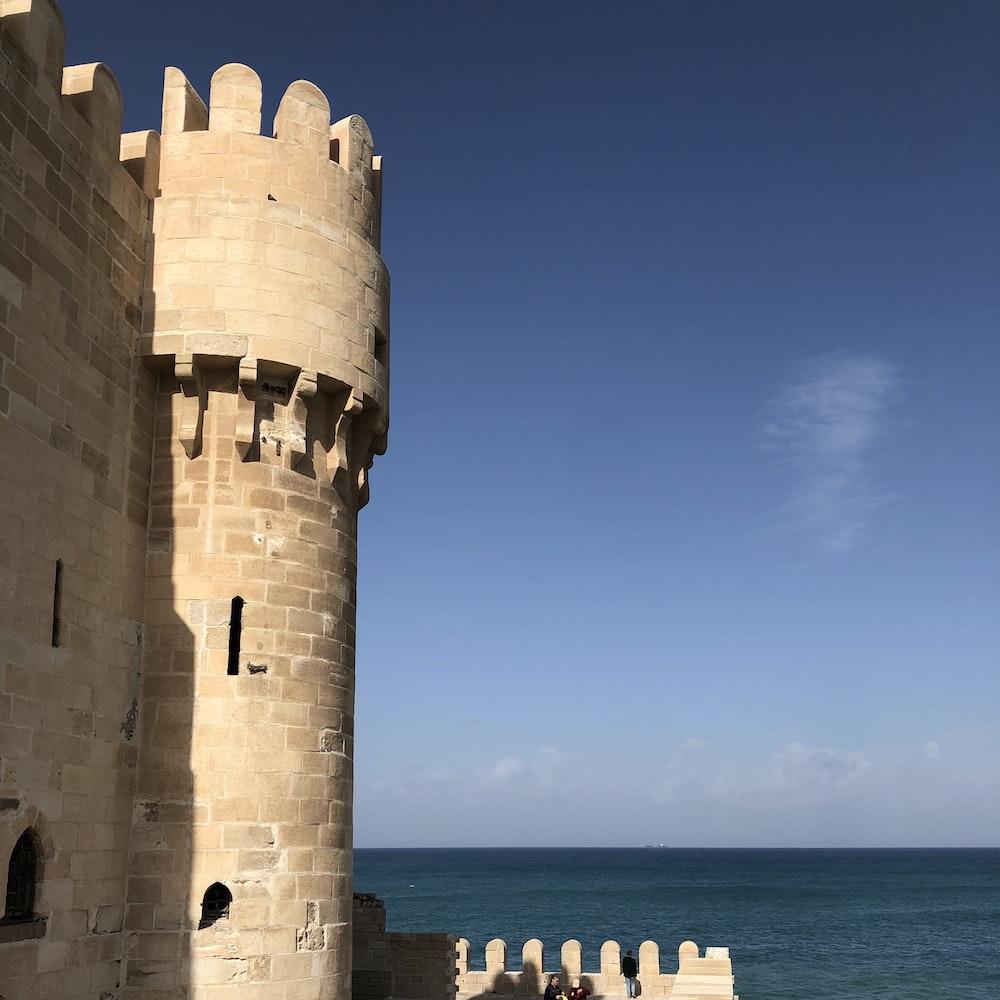 gray brick castle near ocean