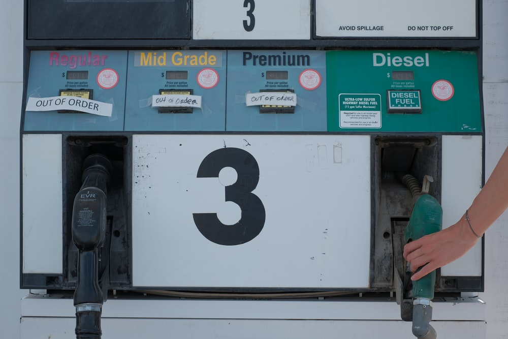 white and green gas pump
