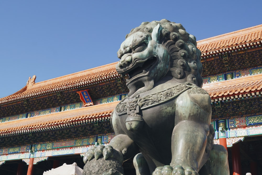 brown animal statue in front of temple