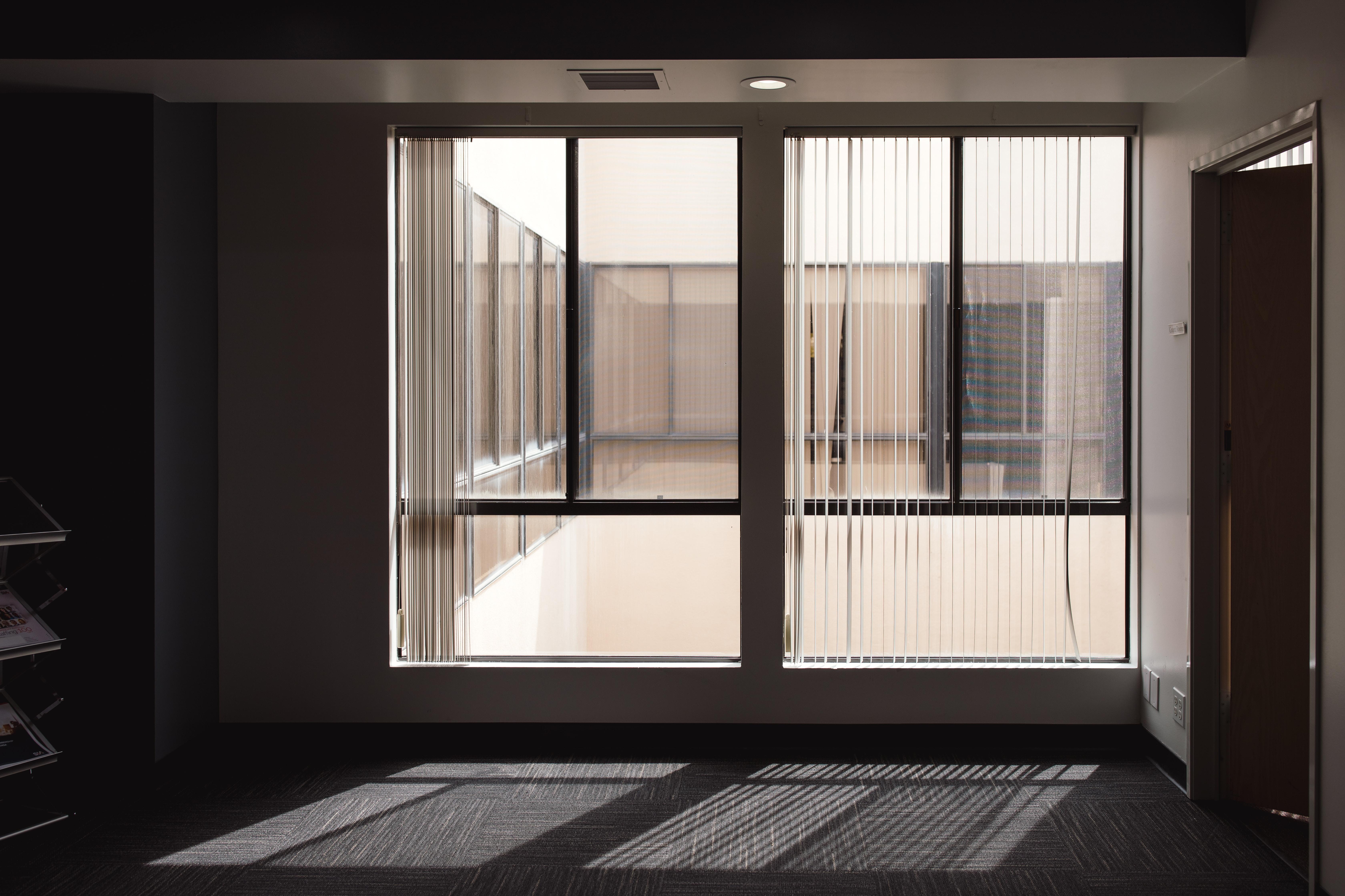 white wooden framed window inside room