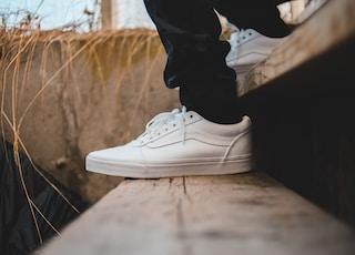 person wearig white Vans low-top sneakers