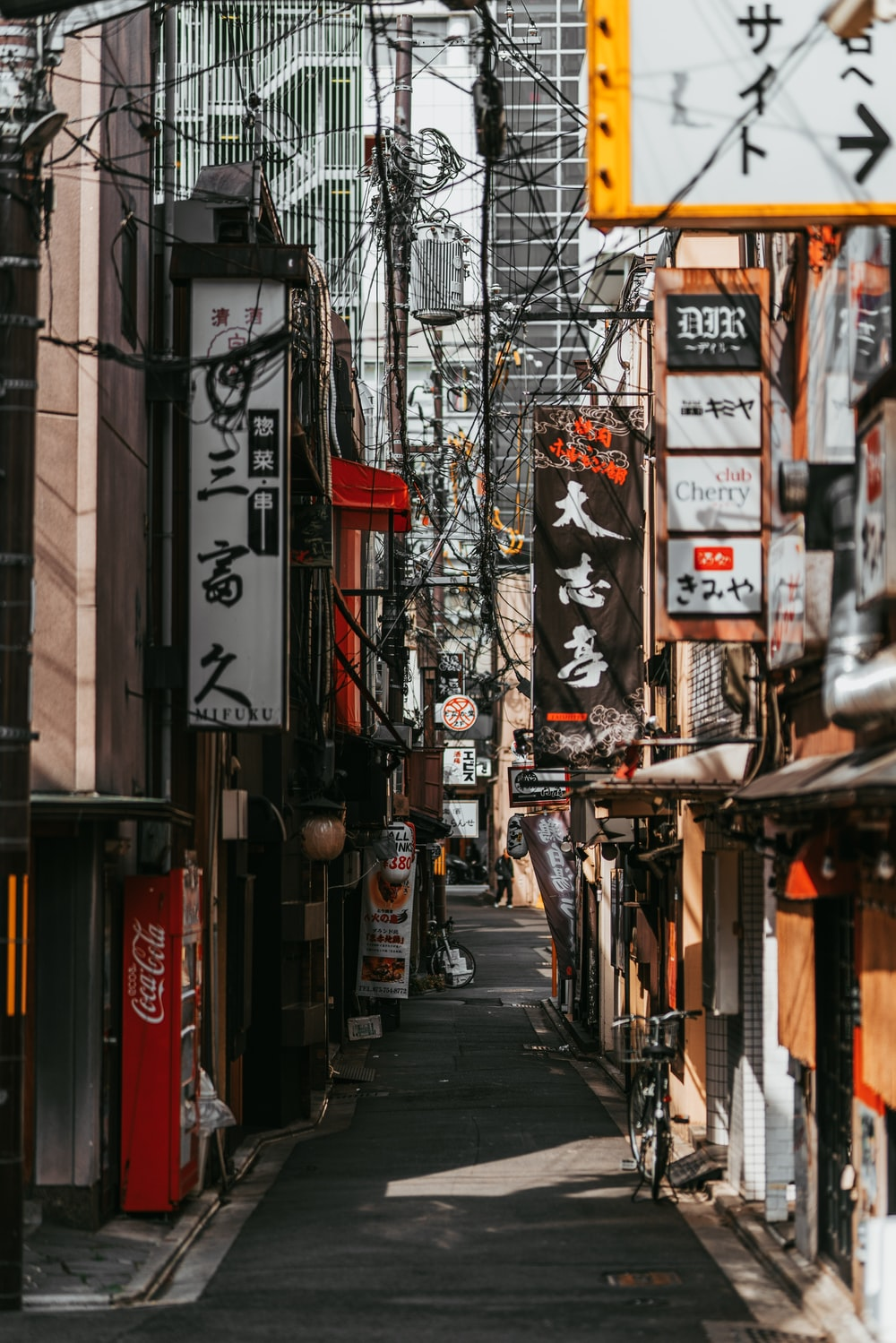 empty pathway between storefronts