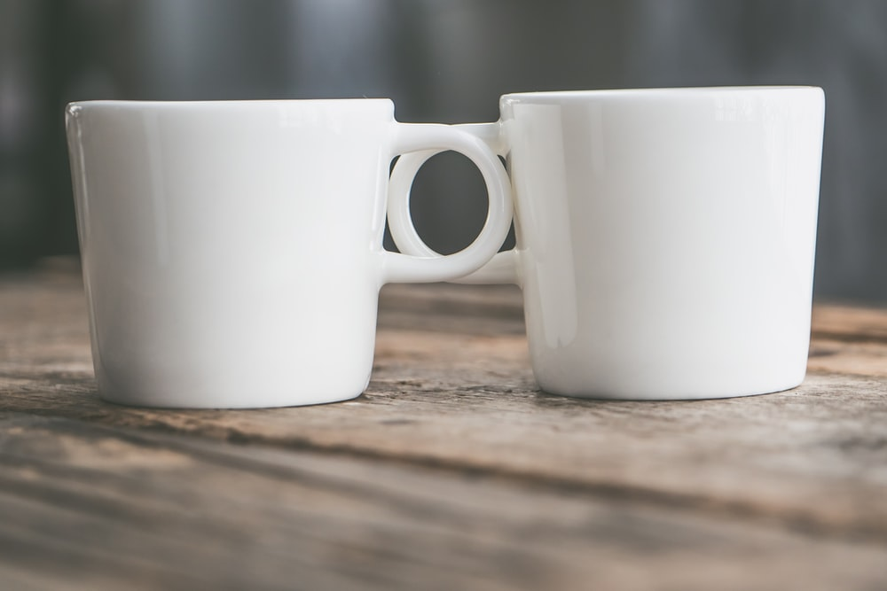 two white ceramic mugs
