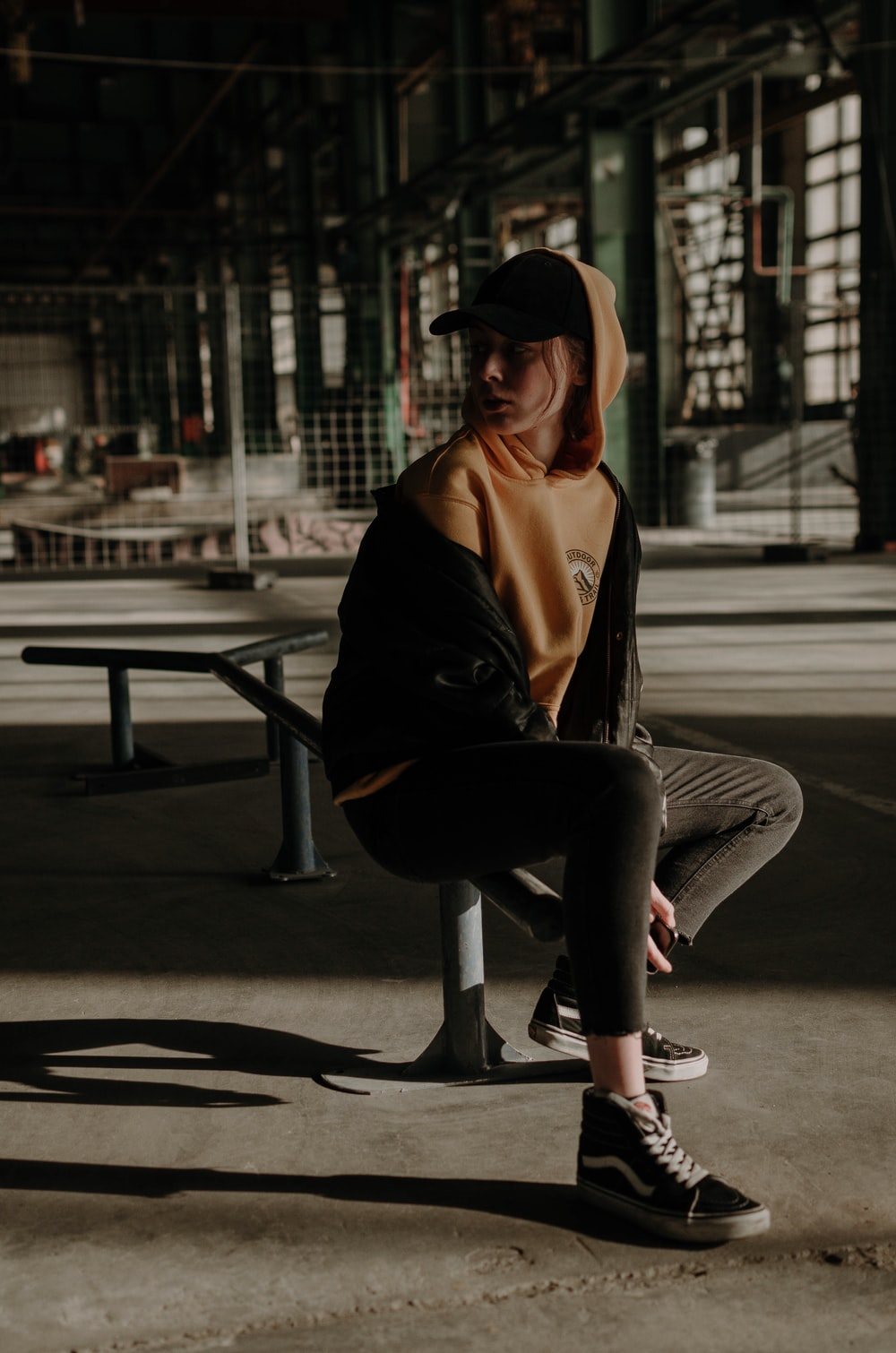 woman sits on skate rail