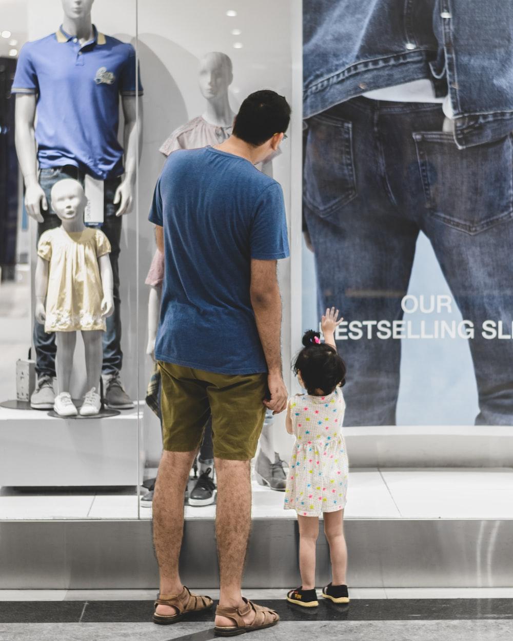 man standing beside girl